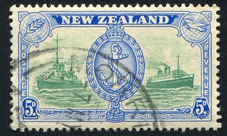 NEW ZEALAND - CIRCA 1946: stamp printed by New Zealand, shows Badge of Royal Navy, circa 1946 photo