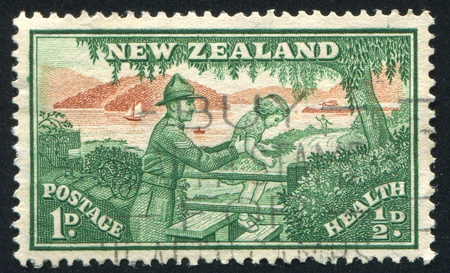 NEW ZEALAND - CIRCA 1945: stamp printed by New Zealand, shows Soldier Helping Child over Stile, circa 1945 photo