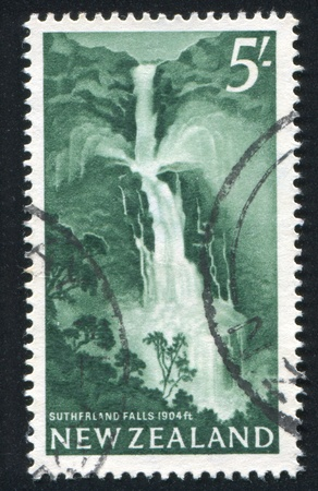 NEW ZEALAND - CIRCA 1960: stamp printed by New Zealand, shows Sutherland Falls, circa 1960 photo