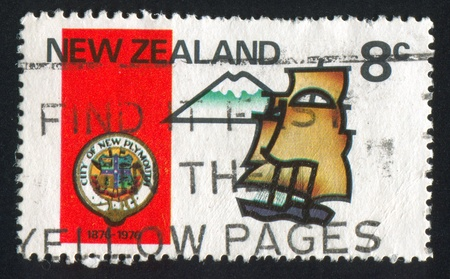 emigrant: NEW ZEALAND - CIRCA 1976: stamp printed by New Zealand, shows 1st emigrant ship   and Mt. Egmont, century of New Plymouth, circa 1976