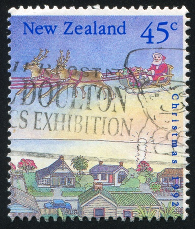 NEW ZEALAND - CIRCA 1992: stamp printed by New Zealand, shows Christmas, Two reindeer pulling Santa's sleigh, circa 1992 photo