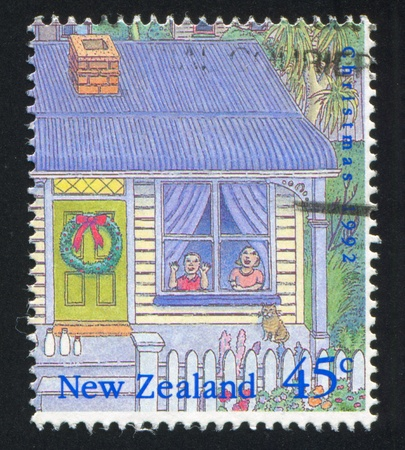 NEW ZEALAND - CIRCA 1992: stamp printed by New Zealand, shows Christmas, Two children looking out window, circa 1992 Stock Photo - 13098060