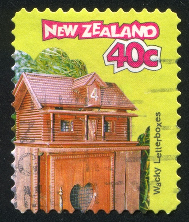 NEW ZEALAND - CIRCA 1997: stamp printed by New Zealand, shows Letterbox Log House, circa 1997 Stock Photo - 13095936