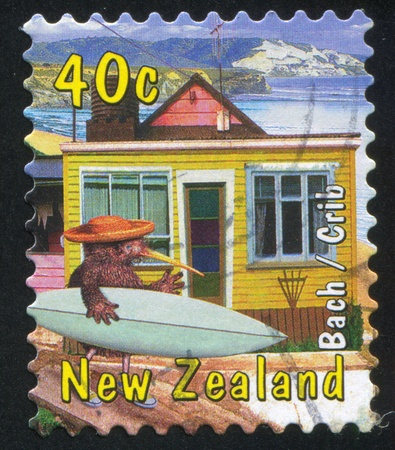 NEW ZEALAND - CIRCA 2000: stamp printed by New Zealand, shows Kiwi with Beach House and Surf Board, circa 2000 photo