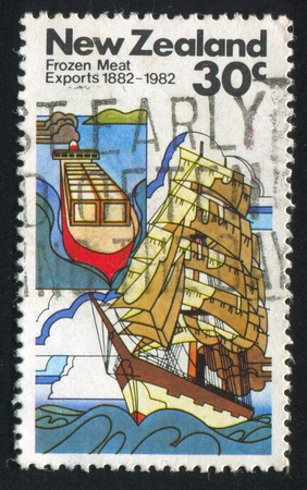 NEW ZEALAND - CIRCA 1982: stamp printed by New Zealand, shows sailing ship with frozen meat, circa 1982 photo