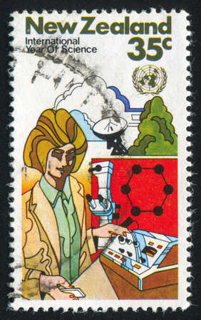 NEW ZEALAND - CIRCA 1982: stamp printed by New Zealand, shows scientist and instrument, circa 1982 Stock Photo - 13095899