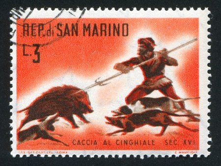 SAN MARINO - CIRCA 1961: stamp printed by San Marino, shows Wild boar hunt, circa 1961 photo
