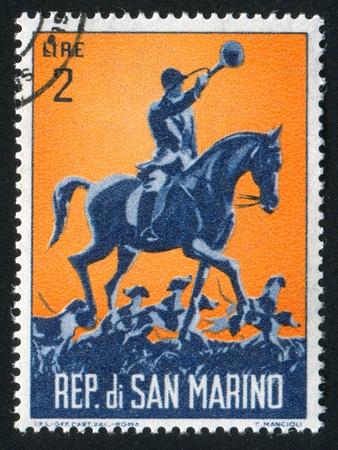 cap hunting dog: SAN MARINO - CIRCA 1962: stamp printed by San Marino, shows Hound Master on horseback, circa 1962
