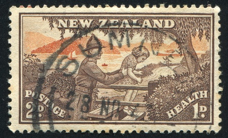 NEW ZEALAND - CIRCA 1945: stamp printed by New Zealand, shows Soldier Helping Child over Stile, circa 1945