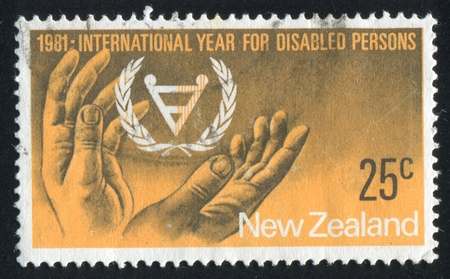 NEW ZEALAND - CIRCA 1981: stamp printed by New Zealand, shows International year for disabled persons, circa 1981 新聞圖片