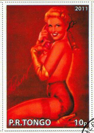 TONGO - CIRCA 2011: stamp printed by Tongo, shows Pin-up girl, by Earl MacPherson, circa 2011