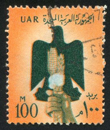 EGYPT - CIRCA 1971: stamp printed by Egypt, shows Eagle, Arms of Egypt, circa 1971.