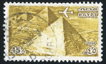 EGYPT - CIRCA 1963: stamp printed by Egypt, shows Airplane over Giza Pyramids, circa 1963.