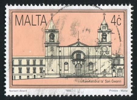 window seal: MALTA - CIRCA 1992: stamp printed by Malta, shows St. Johns Cathedral, circa 1992