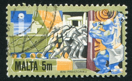 MALTA - CIRCA 1981: stamp printed by Malta, shows Men Hauling Building Stone, circa 1981