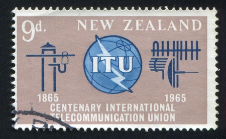 NEW ZEALAND - CIRCA 1965: stamp printed by New Zealand, shows ITU Emblem, Old and New Communication Equipment, circa 1965 Stock Photo - 13265828