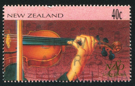 NEW ZEALAND - CIRCA 1996: stamp printed by New Zealand, shows New Zealand Symphony Orchestra, Violin, circa 1996