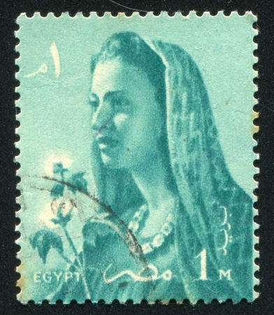 EGYPT - CIRCA 1957: stamp printed by Egypt, shows Farmer's Wife, circa 1957.