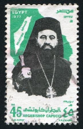 archbishop: EGYPT - CIRCA 1977: stamp printed by Egypt, shows Archbishop Capucci, Map of Palestine, circa 1977