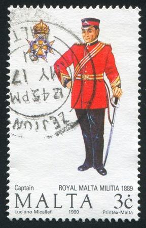 militia: MALTA - CIRCA 1990: stamp printed by Malta, shows Captain of the Royal Malta Militia, circa 1990