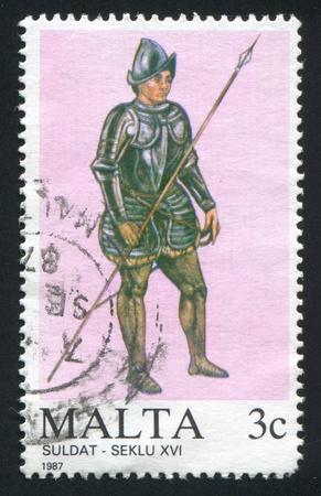 armour plating: MALTA - CIRCA 1987: stamp printed by Malta, shows Soldier of the 16th century, circa 1987