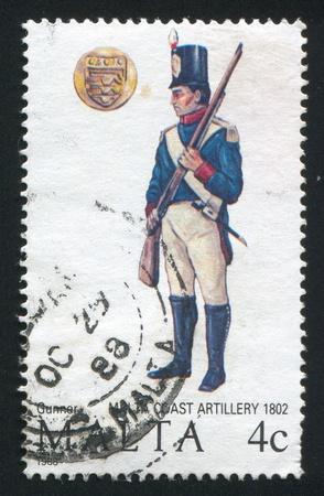 MALTA - CIRCA 1988: stamp printed by Malta, shows Coast Artillery Gunner, circa 1988 Редакционное