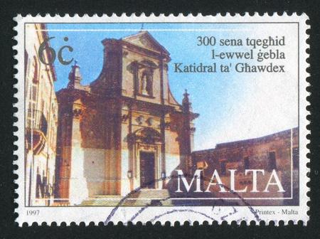 MALTA - CIRCA 1997: stamp printed by Malta, shows Gozo Cathedral, circa 1997 photo