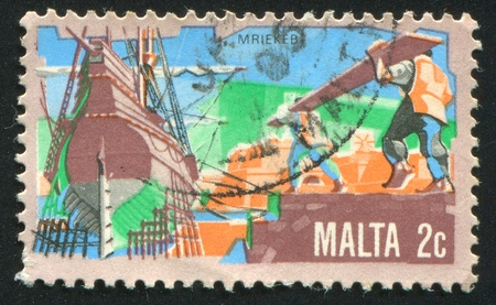 MALTA - CIRCA 1981: stamp printed by Malta, shows Ship Building, circa 1981 Stock Photo - 13353640