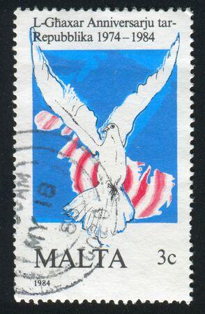MALTA - CIRCA 1984: stamp printed by Malta, shows Dove on Map, circa 1984
