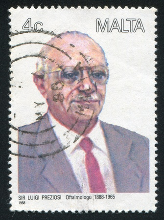MALTA - CIRCA 1988: stamp printed by Malta, shows Ophthalmologist Luigi Preziosi, circa 1988 Stock Photo - 13353651