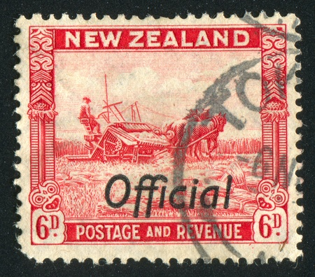 NEW ZEALAND - CIRCA 1935: stamp printed by New Zealand, shows Harvesting, circa 1935 Stock Photo - 13353715