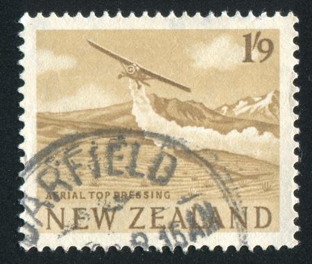 NEW ZEALAND - CIRCA 1963: stamp printed by New Zealand, shows Plane spraying farmland, circa 1963 Stock Photo - 13353723