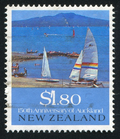 NEW ZEALAND - CIRCA 1990: stamp printed by New Zealand, shows Rangitoto Island, Takapuna Beach, Auckland, Yacht, circa 1990