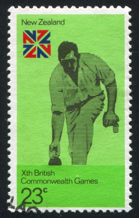 NEW ZEALAND - CIRCA 1974: stamp printed by New Zealand, shows Lawn bowling and British Commonwealth Games Emblem, circa 1974