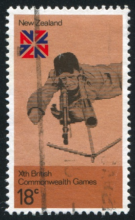 backsight: NEW ZEALAND - CIRCA 1974: stamp printed by New Zealand, shows Rifle shooting and British Commonwealth Games' Emblem, circa 1974