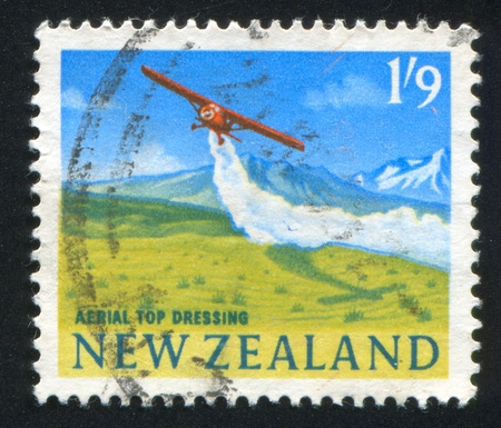 NEW ZEALAND - CIRCA 2001: stamp printed by New Zealand, shows Airplane Dispersing Agricultural Chemicals From Air, circa 2001 photo