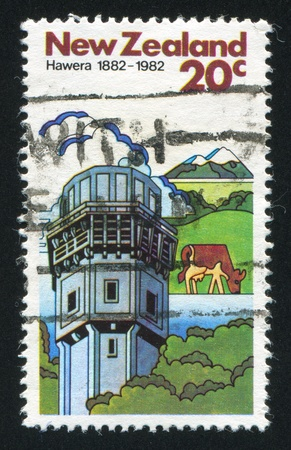 NEW ZEALAND - CIRCA 1982: stamp printed by New Zealand, shows Cows and Dairy Factory in Hawera, circa 1982