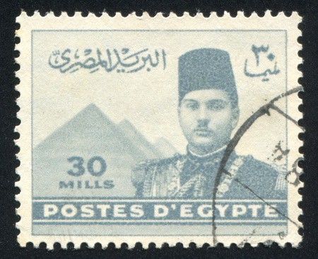 EGYPT - CIRCA 1939: stamp printed by Egypt, shows King Farouk and Pyramids, circa 1939.