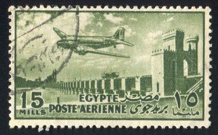 EGYPT - CIRCA 1953: stamp printed by Egypt, shows Airplane over Bridge, circa 1953