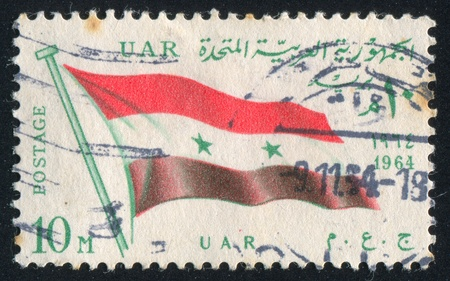 EGYPT - CIRCA 1964: stamp printed by Egypt, shows flag UAR, circa 1964.