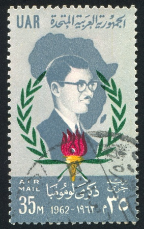 EGYPT - CIRCA 1962: stamp printed by Egypt, shows Patrice Lumumba and Map of Africa, circa 1962.