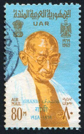 mahatma: EGYPT - CIRCA 1969: stamp printed by Egypt, shows Mahatma Gandhi, Arms of India and UAR, circa 1969. Editorial