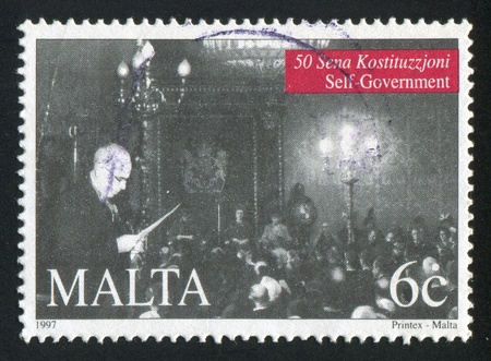 MALTA - CIRCA 1997: stamp printed by Malta, shows Man Looking at Paper, Group of People, circa 1997