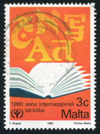 MALTA - CIRCA 1990: stamp printed by Malta, shows Opened Book, circa 1990 Stock Photo - 13460829