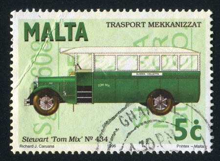 jalopy: MALTA - CIRCA 1996: stamp printed by Malta, shows Bus Stewart Tom Mix, circa 1996 Editorial