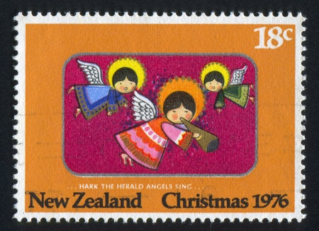 """hark: NEW ZEALAND - CIRCA 1976: stamp printed by New Zealand, shows Christmas, """"Hark the Herald Angels Sing,"""", circa 1976"""