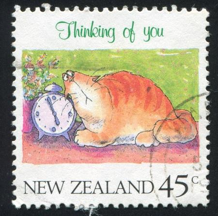 thinking of you: NEW ZEALAND - CIRCA 1991: stamp printed by New Zealand, shows Thinking of You, Cat and alarm clock, circa 1991