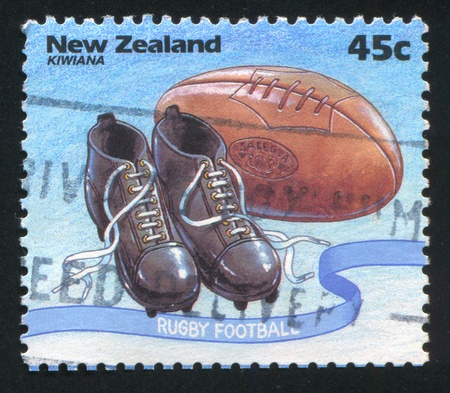 NEW ZEALAND - CIRCA 1994: stamp printed by New Zealand, shows Kiwiana, Rugby shoes, ball, circa 1994