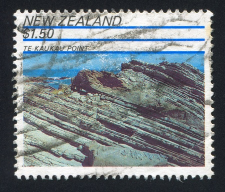 NEW ZEALAND - CIRCA 1991: stamp printed by New Zealand, shows Rock Formations, Te Kaukau Point, circa 1991 Stock Photo - 13461044