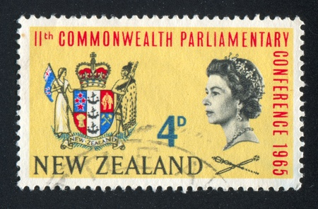 NEW ZEALAND - CIRCA 1965: stamp printed by New Zealand, shows Queen Elizabeth II and New Zealand Coat of Arms, circa 1965 Stock Photo - 13460934
